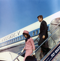 President Kennedy and the First Lady exit Air Force One.