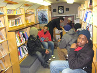 Inside the Queens Library Book Bus, people from Rockaway Peninsula take shelter. Photo courtesy of Queens Library
