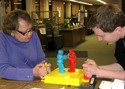 Library director LeAnn Dean (left) battles it out with another gamer at a Rock 'Em Sock 'Em Robots match. (Photo: Rodney A. Briggs Library)