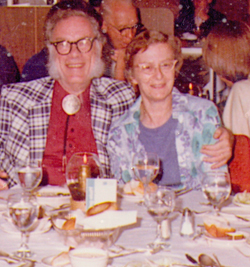 Ruth Freitag, seated with admirer Isaac Asimov on an Astronomical Society cruise
