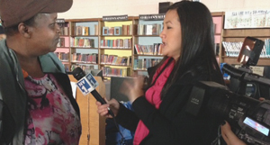 Sharon Anderson, manager of Queens Library's Far Rockaway branch, talks with NY1-TV reporter Suemyra Shah.