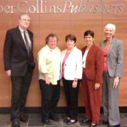 Virginia Stanley (second from left), director of library marketing at HarperCollins, greets ALA delegation members Bob Wolven, Maureen Sullivan, Molly Raphael, and Barbara Stripling.