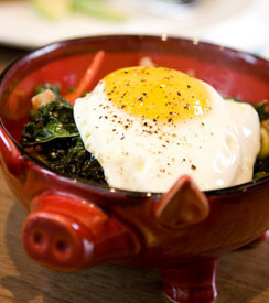 Pig's Ear with crispy kale, pickled cherry peppers and fried egg at The Purple Pig