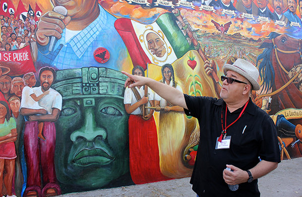Alberto Pulido, professor and chair of the department of ethnic studies at the University of San Diego, gives a tour of Chicano Park in San Diego's Logan Heights community during the fifth Reforma conference. The park, which is celebrating its 45-year history, is home to the country's largest collection of outdoor murals.
