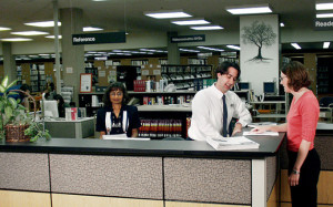 The author (wearing a tie) at the reference desk before her transition.