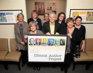 The April announcement of the Soon to Be Famous Author Project winner took place at the Illinois Library Association in Chicago. Front, from left: Denise Raleigh, Michael Alan Peck, and Cris Cigler. Back, from left: Donna Fletcher, Julie Stam, Lucy Tarabour, Nikki Zimmermann, and Jennifer Amling.