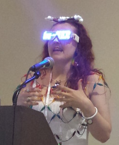 Tenaya Hurst showing LED headgear and glasses