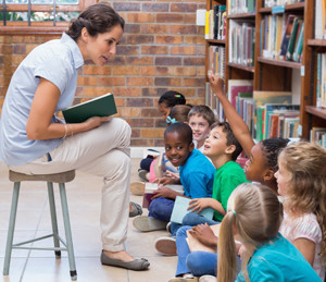 Librarian reads to students