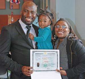 Oluwaleke Kehinde Ajayi receives his certificate of naturalization.