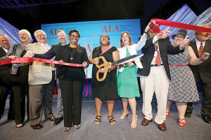 Past President Courtney L. Young cuts the ribbon after the Opening General Session on June 26.