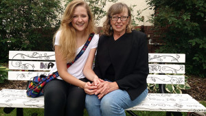 Two local artists who helped create benches for Columbus (Wis.) Public Library's pilot program.