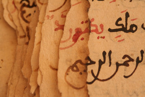 Image of damaged pages from a manuscript in Timbuktu showing the effects of chipping. (Photo: Alexio Motsi and Mary Minicka for the Timbuktu Manuscripts Project.)