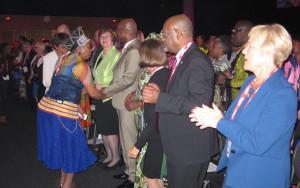 Storyteller Gcina Mhlophe (left) dances with delegates.