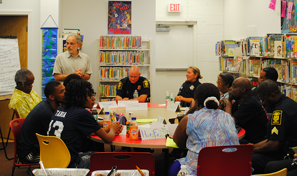 Richard Frieder (standing), community engagement director at Hartford Public Library, facilitates a community dialogue among neighborhood residents and Hartford police officers on the topic of community violence and public safety. The dialogue took place in June 2015 at Hartford Public Library's Barbour Street branch. (Photo: Judy Wyman Kelly)