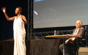 Chi Mhende as Hypatia and David Muller as a journalist in The Hypatiad at IFLA's World Library and Information Congress in Cape Town, South Africa.