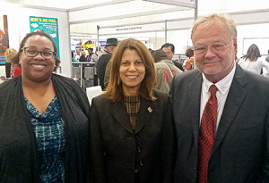 (left to right) ALA Past President Courtney Young, current ALA President Sari Feldman, and ALA Executive Director Keith Michael Fiels in the WLIC exhibits hall. Photo: George M. Eberhart