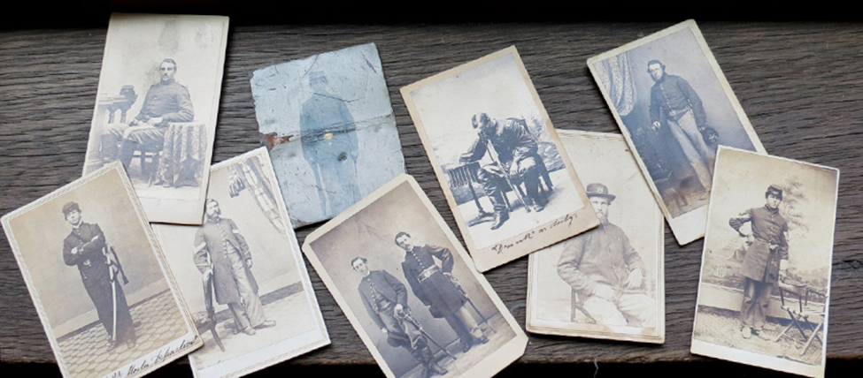 A few of the 75 Civil War–era photographs that were taken from Bangor (Maine) Public Library and later recovered. These images, along with 50 original World War I– and World War II–era posters that were stolen, had an estimated value of $31,000. The image of the officer leaning over his chair helped identify the set as belonging to the library.