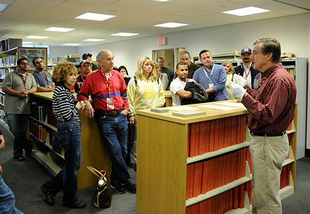 Hall of Fame Librarian Jim Gates gives VIP Experience guests a tour of the Museum's Giamatti Research Center.