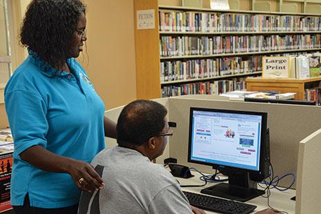 Marilynn Lance-Robb, branch manager at the Carvers Bay Branch Library in Georgetown, South Carolina, assists a patron with health information. Photo: Marilynn Lance-Robb