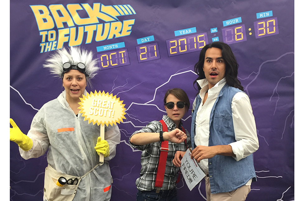 Salt Lake City Public Library System staffers pose as characters from the Back to the Future films. From left, teen services coordinator Christina Walsh as Doc Brown, children's services coordinator Liesl Johnson as Marty McFly, and adult services coordinator Tommy Hamby as Jennifer Parker. Photo: Salt Lake City Public Library System
