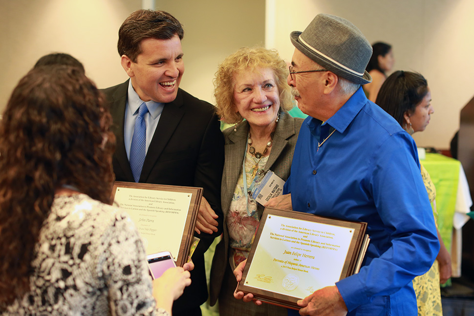 2015 Pura Belpré Illustration Honoree John Parra (left), conference attendee Cecilia Matsko, and 2015 Pura Belpré Author Honoree Juan Felipe Herrera gather during the 2015 ALA Annual Conference in San Francisco.