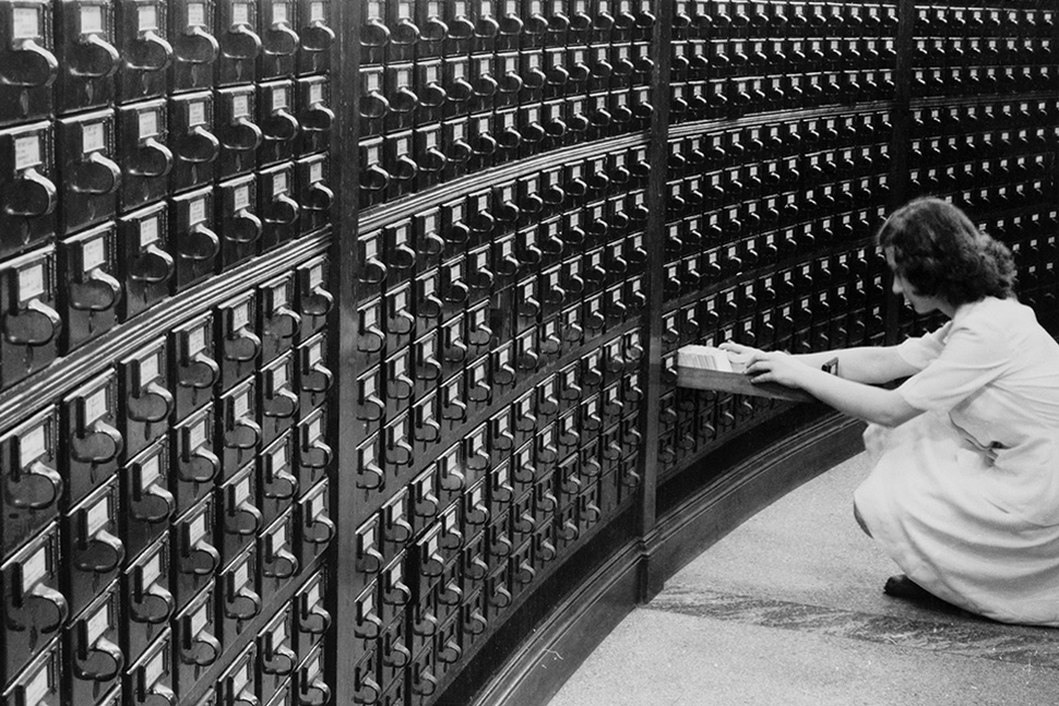 A woman using the card catalog at the main reading room of the Library of Congress, circa 1940.
