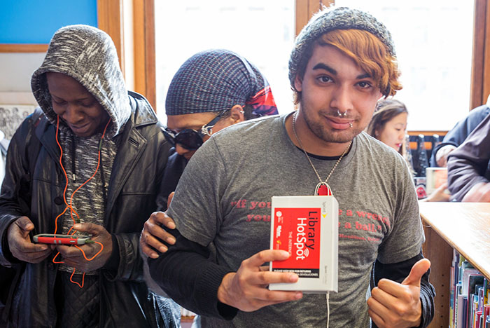 New mobile hotspot users attend a launch event at New York Public Library's Mott Haven branch.