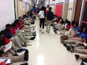 """Students stage a """"read-in"""" in the school's hallways to protest the closing of the library."""
