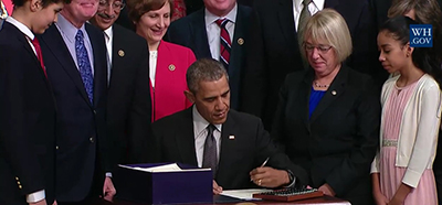 President Obama signs the Every Student Succeeds Act
