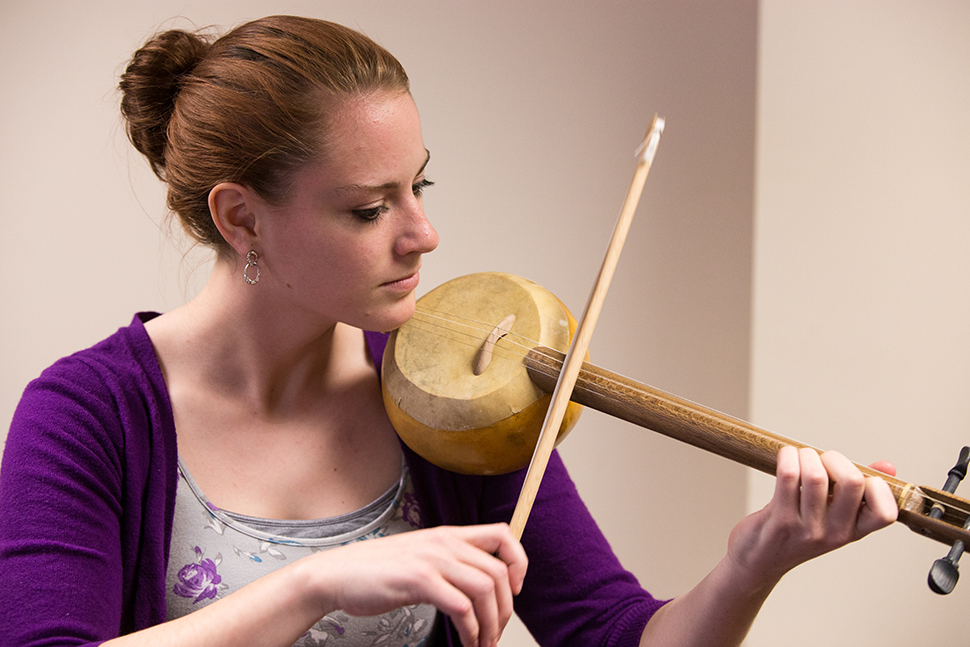 A music therapy student (a violinist) demonstrates how she experimented playing the Turkish spike fiddle before finding more official instructions.
