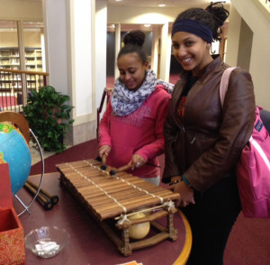 Students try out a West African balafon, a wooden xylophone-like instrument.
