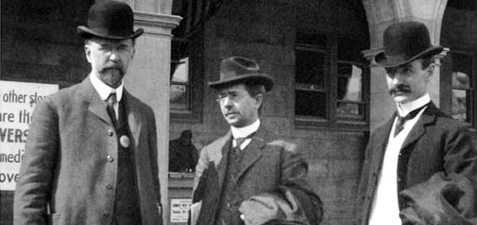ALA officials stand in front of the Hall of Congresses at the St. Louis World's Fair, 1904: (left to right) ALA President-Elect Ernest Cushing Richardson, former ALA President Reuben Gold Thwaites, and ALA President Herbert Putnam. Richardson wears one of the white buttons that identifies him as an ALA conference attendee. Credit: ALA Archives