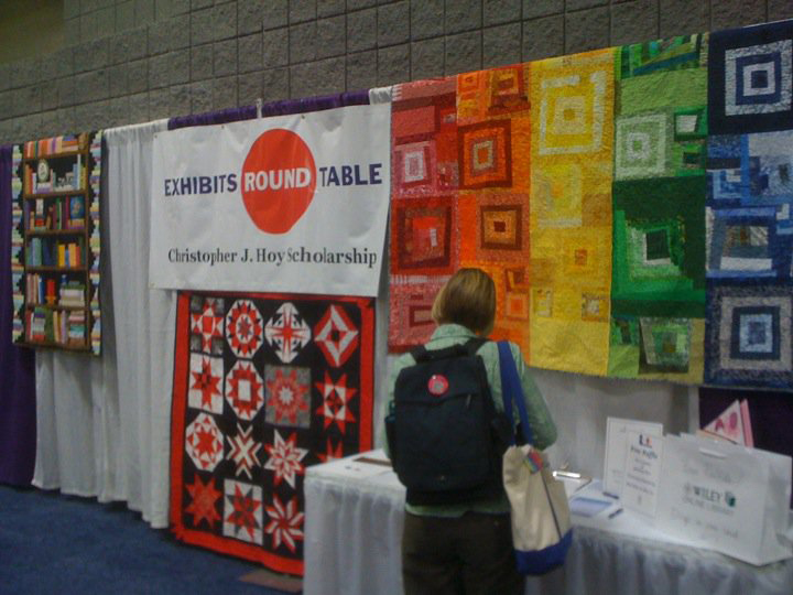The ALA BiblioQuilters display their quilts at the 2010 Annual Conference in Washington, D.C. Quilts are auctioned off to raise money for the Christopher J. Hoy Scholarship.