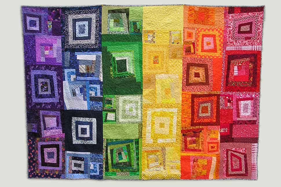 Auctioned at the 2010 Annual Conference in Washington, D.C., this multichromatic quilt coordinated by Rachel Ivy Clarke, a graduate student at the University of Washington in Seattle, uses scraps and other fabrics that may have otherwise been thrown away. Group members were encouraged to contribute blocks in colors of red, orange, yellow, green, blue, and purple.