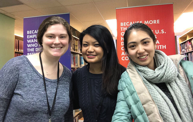 UMSI Alternative Spring Break interns Alyssa Hanson, Gita Serpuja, and Yining Zhou in the ALA Library.