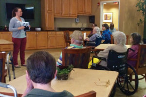 "Marie Corbitt, outreach program librarian at Westerville (Ohio) Public Library, leads a ""Remember When"" storytime at a nursing facility. Photo: Westerville (Ohio) Public Library"
