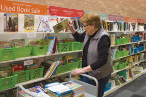 Kathy Clay, president of the ­Waukegan Public Library's Friends of the Library, restocks children's book for an upcoming book sale. Photo: Rebecca Lomax/American Libraries