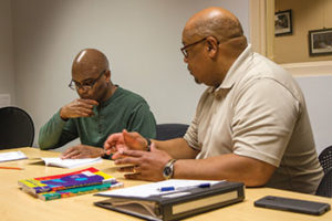 Louie Summers Jr. (right) tutors as part of Waukegan (Ill.) Public Library's adult literacy tutoring program; Photo: Rebecca Lomax/American Libraries