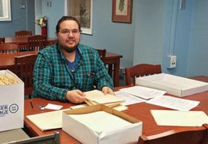 Nicholas Mason, an undergraduate at University of North Carolina at Greensboro, processes a manuscript collection at Jackson Library. Photo: Kathelene Smith