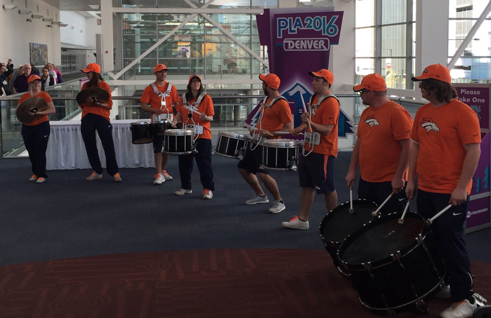 A drum line energizes the crowd and opens the exhibit hall at the Public Library Association Conference in Denver.