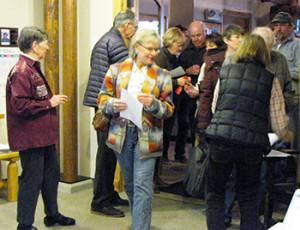 Library trustees and Friends of the Library helped admit the ticketed attendees to the event.