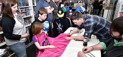 Batman Writer Scott Snyder signs autographs for DC Comics' Free Comic Book Day Special Issue at Fourth World Comics in 2015 in Smithtown, New York