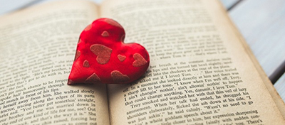 Happy librarian heart on book