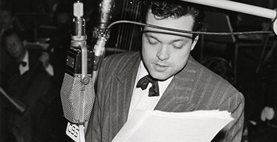 Orson Welles making a radio broadcast