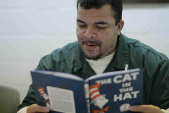 Inmate reads Cat in the Hat (photo: Brooklyn Public Library)