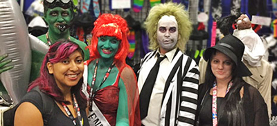Dolly Goyal, branch manager at San Mateo County (Calif.) Library, with Beetlejuice cosplayers