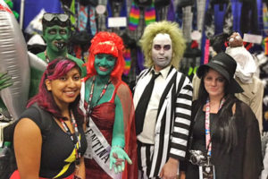 Dolly Goyal, library director at Los Gatos (Calif.) Public Library, with Beetlejuice cosplayers.