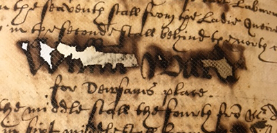 Example of iron gall ink damage and subsequent 20th century repair on Add MS 38599 ca. early 17th century
