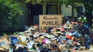 Water-soaked books await pickup outside the flooded Rainelle (W.Va.) Public Library.
