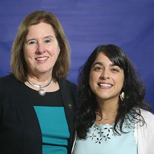 Accepted by Carolyn Anthony (left), retired director, and Amita Lonial, learning experiences manager